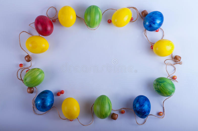 Easter frame from multi-colored eggs stock photos