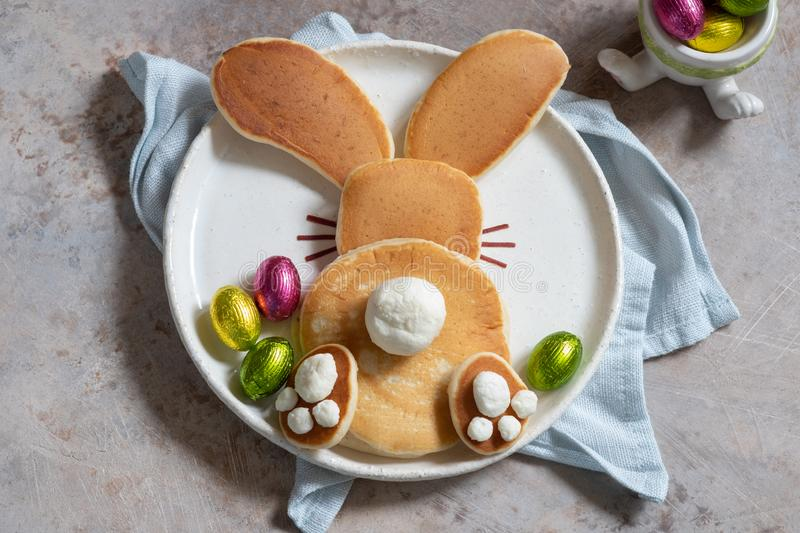 Easter funny bunny pancakes. With chocolate eggs stock images