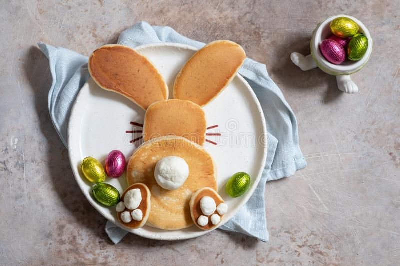 Easter funny bunny pancakes. With chocolate eggs royalty free stock photo
