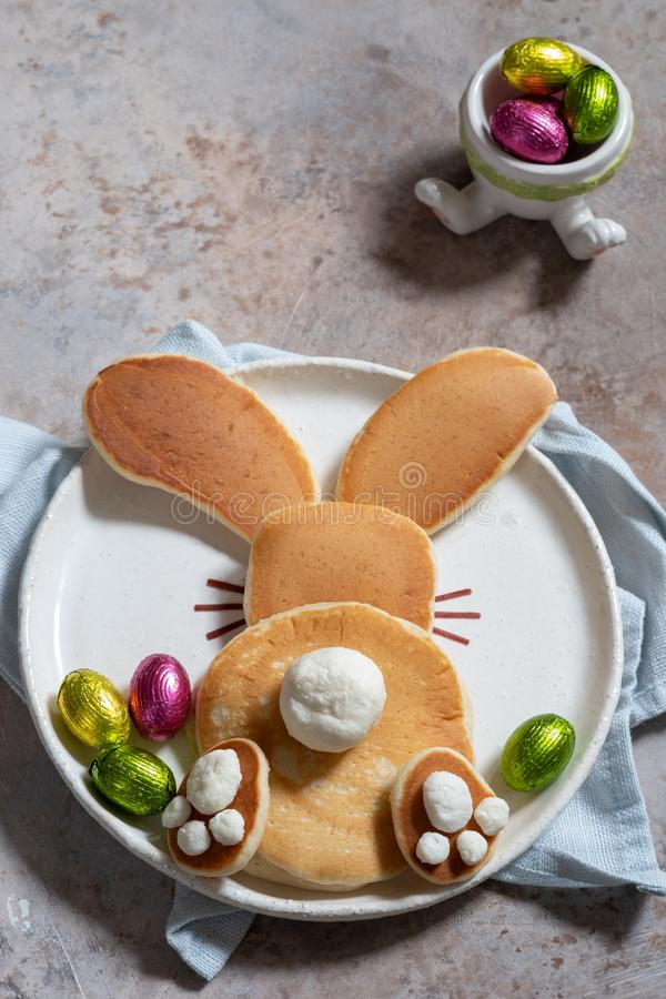 Easter funny bunny pancakes. With chocolate eggs royalty free stock images
