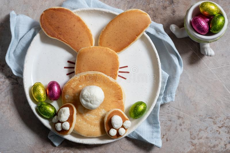 Easter funny bunny pancakes. With chocolate eggs stock photography