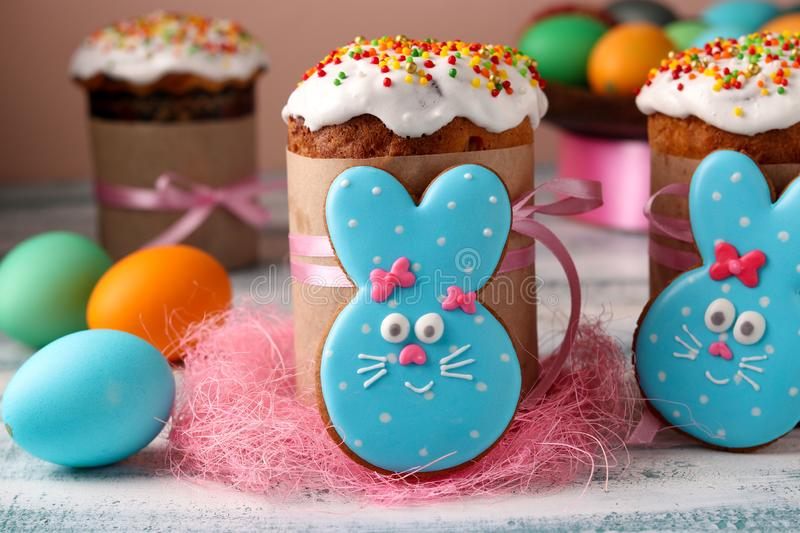 Easter funny rabbits, homemade painted gingerbread biscuits in glaze and Easter cakes, colorful eggs stock photo