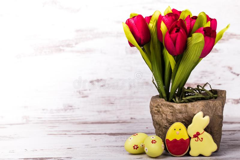 Easter gingerbread cookies and tulips royalty free stock photos