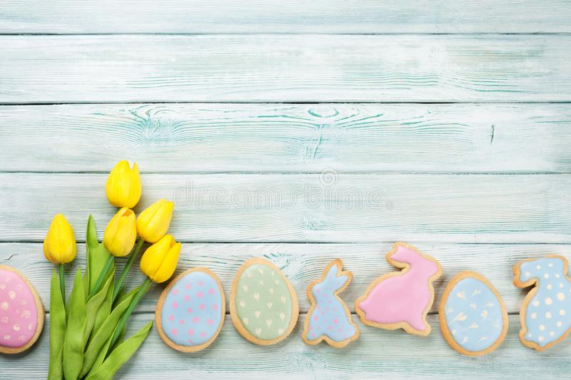 Easter gingerbread cookies and tulips stock image