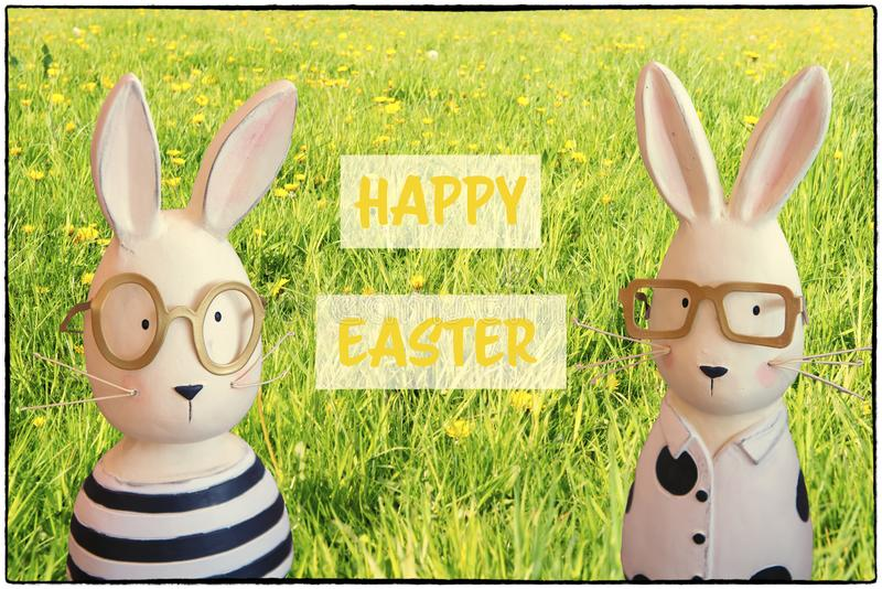 Happy easter - Easter greeting card with bunnies in spring meadow royalty free illustration