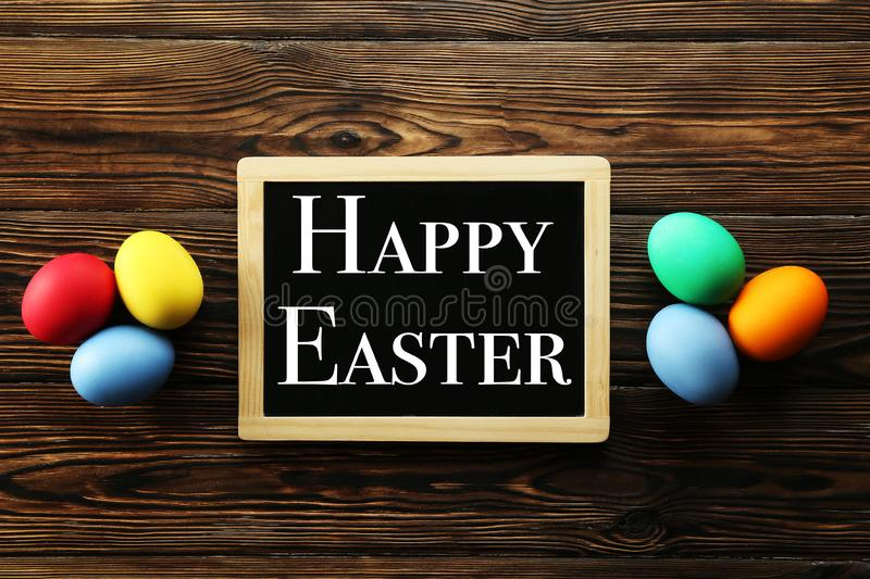 Easter greeting card concept. Festive composition on wooden background royalty free stock images