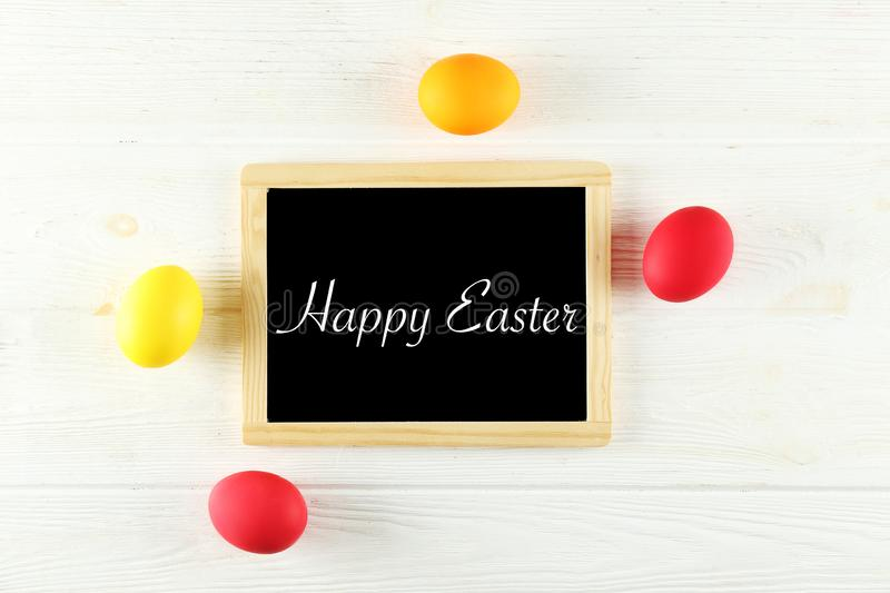 Easter greeting card concept. Festive composition on wooden background stock photo