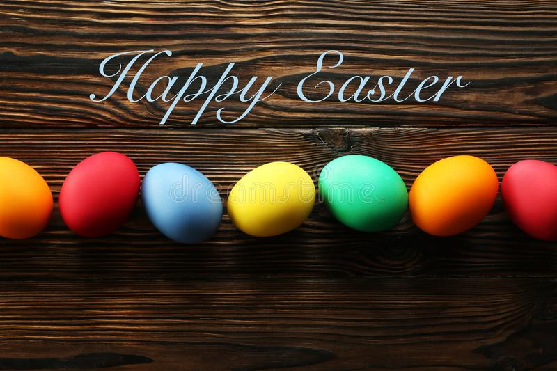 Easter greeting card concept. Festive composition on wooden background royalty free stock photos