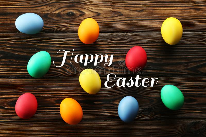 Easter greeting card concept. Festive composition on wooden background royalty free stock image