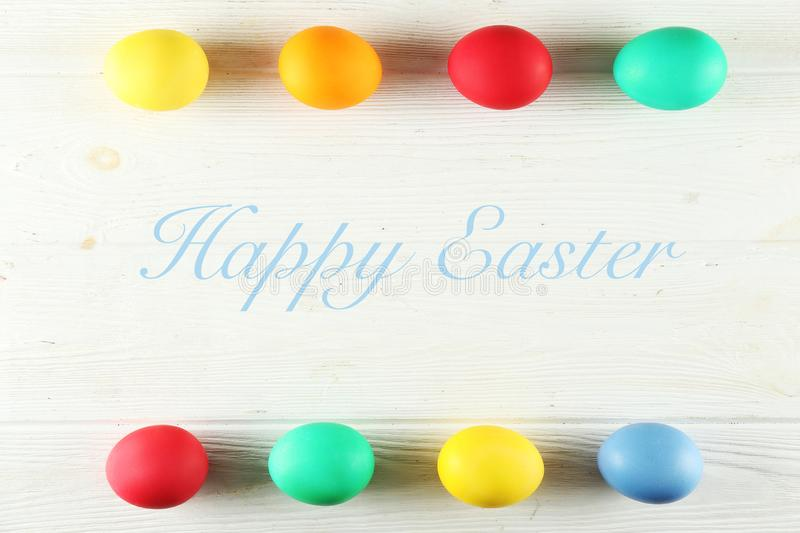 Easter greeting card concept. Festive composition on wooden background stock image