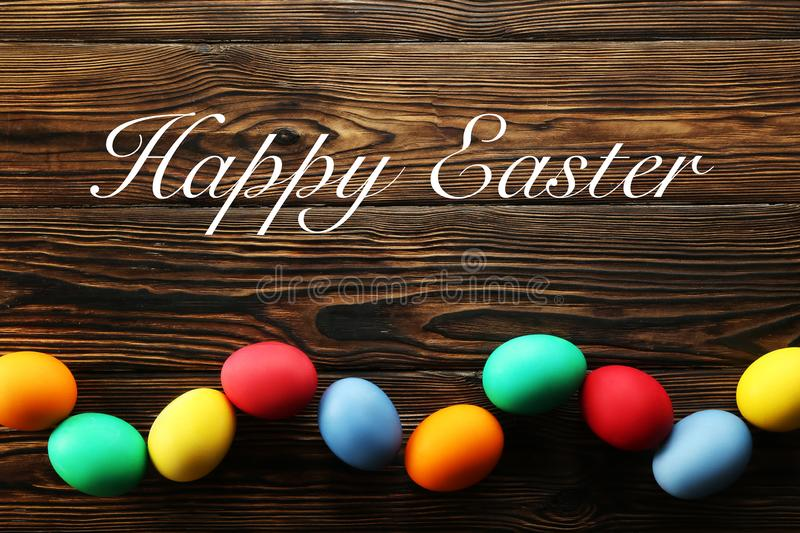 Easter greeting card concept. Festive composition on wooden background stock photography
