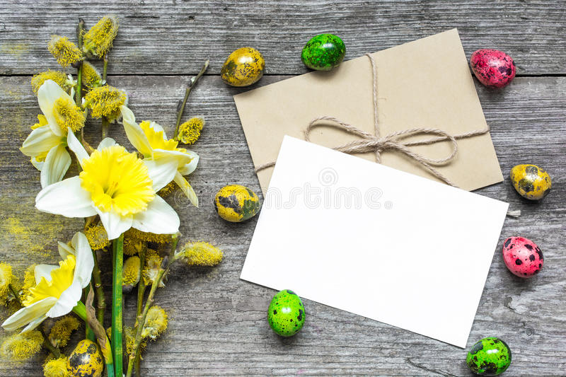 Easter greeting card with easter eggs and spring flowers royalty free stock photos