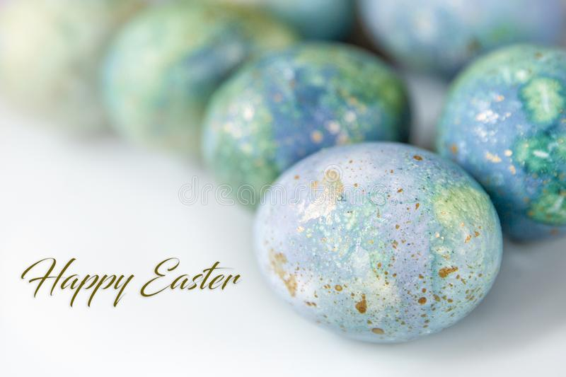 Easter greetings in English. Painted eggs on a light background. Spring and holidays. Easter background. Family traditional holidays. Painted eggs a light stock photos
