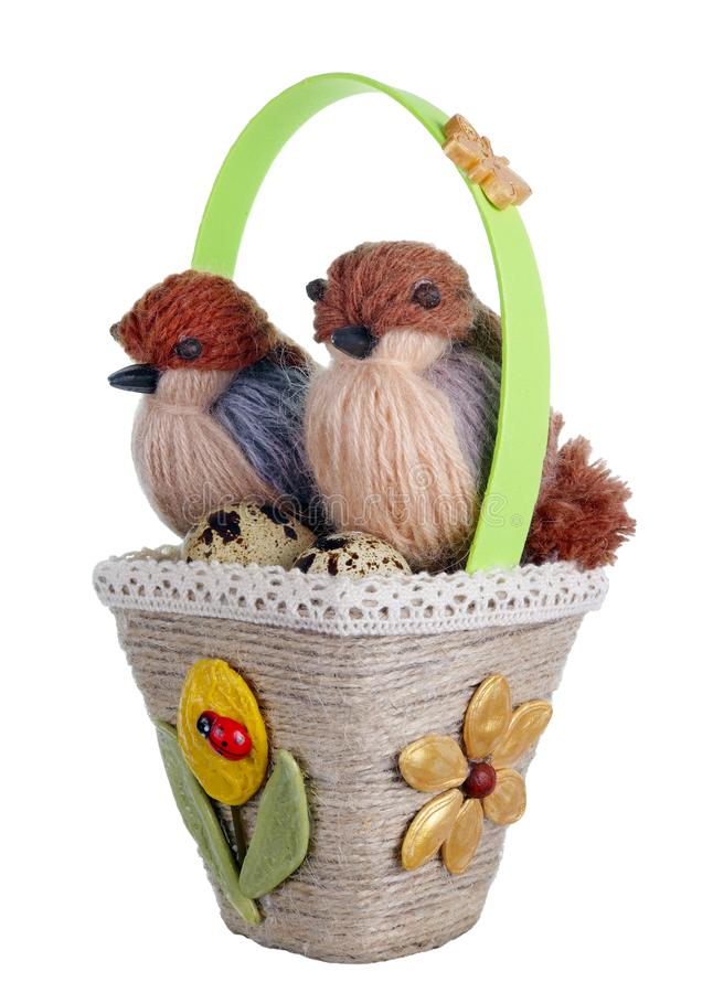 Easter handmade  basket nest from rope and pasta  with funny birds  and quail eggs isolated. Easter handmade  basket nest from rope and pasta  with funny birds stock images
