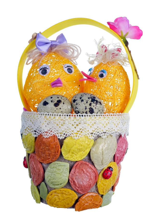 Easter handmade  basket  from rope and pasta  with funny chickens and guail egg isolated. Easter handmade  basket  from rope and pasta  with funny chickens and royalty free stock photos