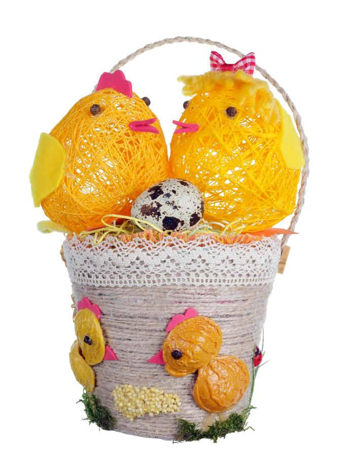 Easter handmade  basket  from rope and pasta  with funny chickens and guail egg isolated. Easter handmade  basket  from rope and pasta  with funny chickens and stock photography