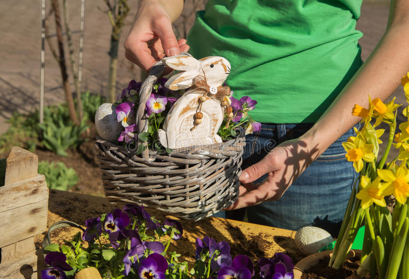 Easter handmade decoration with spring flowers and bunny at home stock images
