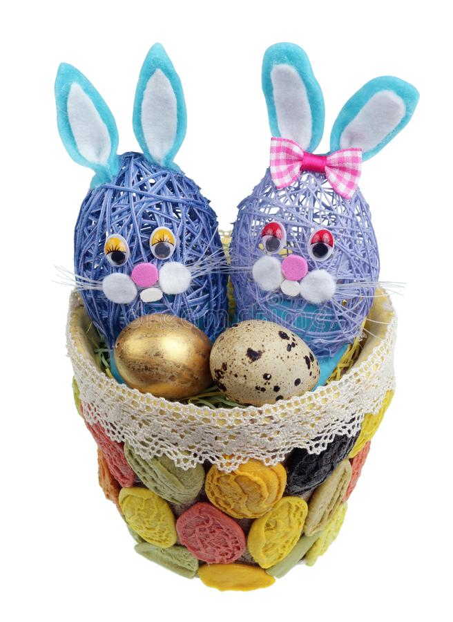 Easter handmade nest from pasta with funny bunnies and quail egg isolated. Easter handmade nest from pasta with funny bunnies and quail egg. Isolated on white royalty free stock image