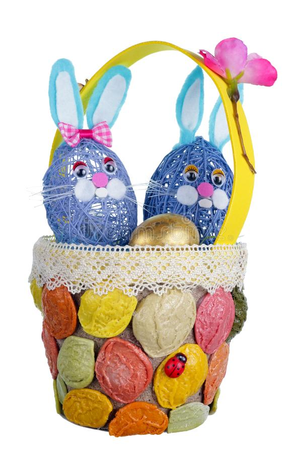 Easter handmade  nest  from  pasta with funny  bunnies and  quail egg isolated. Easter homemade  nest  from  pasta with funny  bunnies and  golden egg. Isolated royalty free stock photography