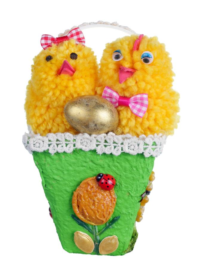 Easter handmade  nest from rope and pasta  with funny chickens and golden egg isolated. Easter handmade  nest from paper and pasta  with funny chickens and royalty free stock photo