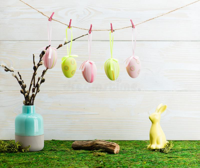 Easter hanging eggs over wooden background royalty free stock image