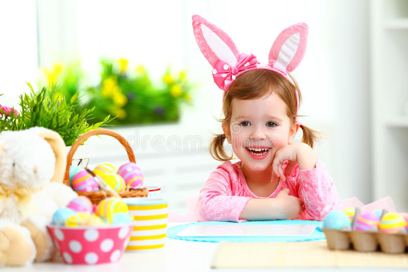 Easter. happy child girl with bunny ears with colored eggs and f stock images