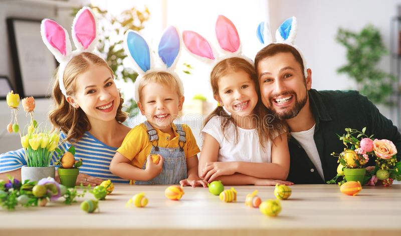 Easter. happy family mother father and children are preparing for holiday home with eggs. Easter. happy family mother father and children are preparing for the stock photos