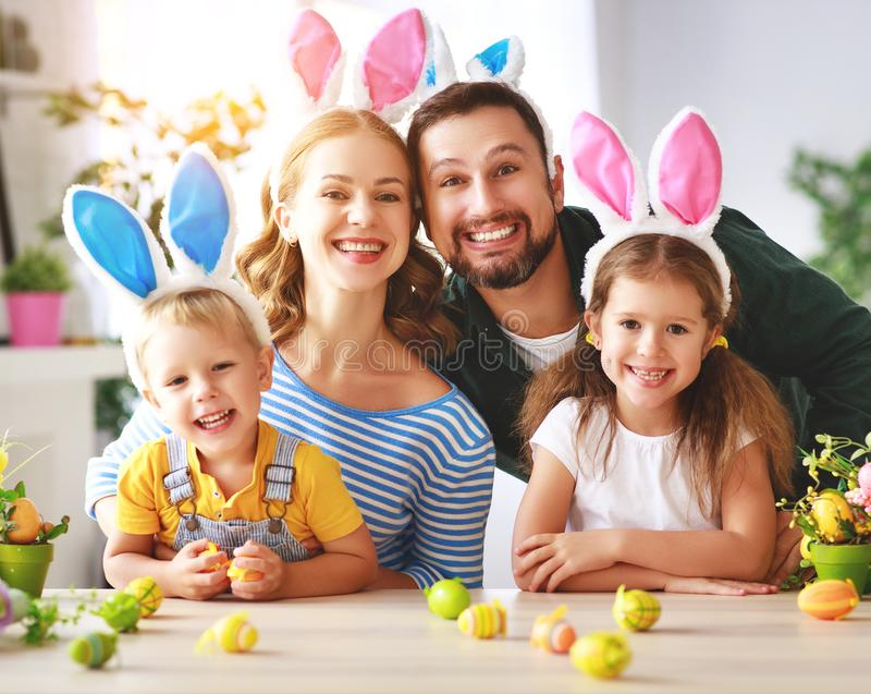 Easter. happy family mother father and children are preparing for holiday home with eggs. Easter. happy family mother father and children are preparing for the stock photo