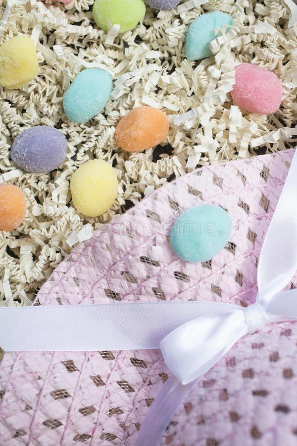 Easter Hat and Gummy Eggs royalty free stock images