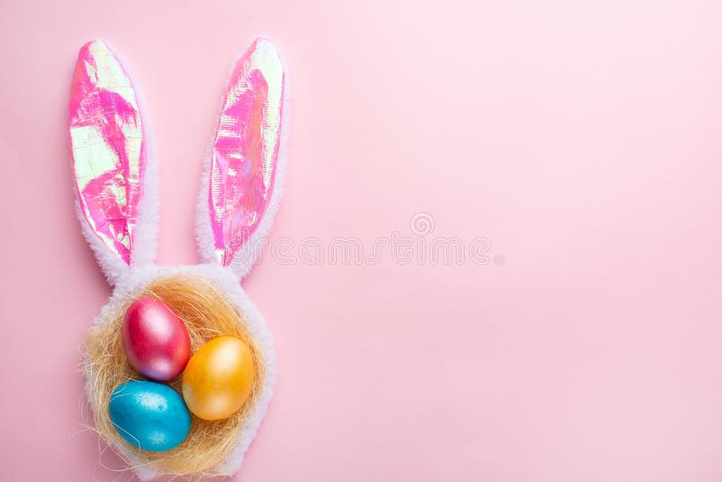 Easter holiday background.Easter egg with ears on a pink background, horizontal composition. Greeting card concept.  royalty free stock photo