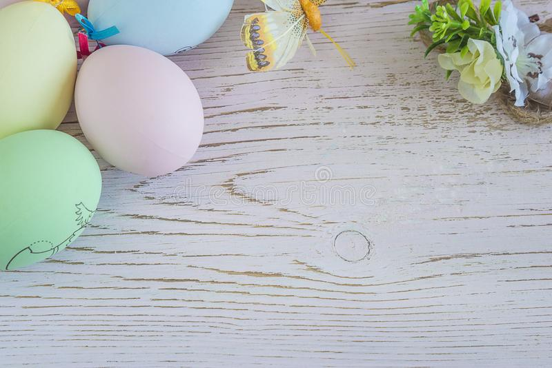 Easter holiday background with pastel colored eggs royalty free stock photography