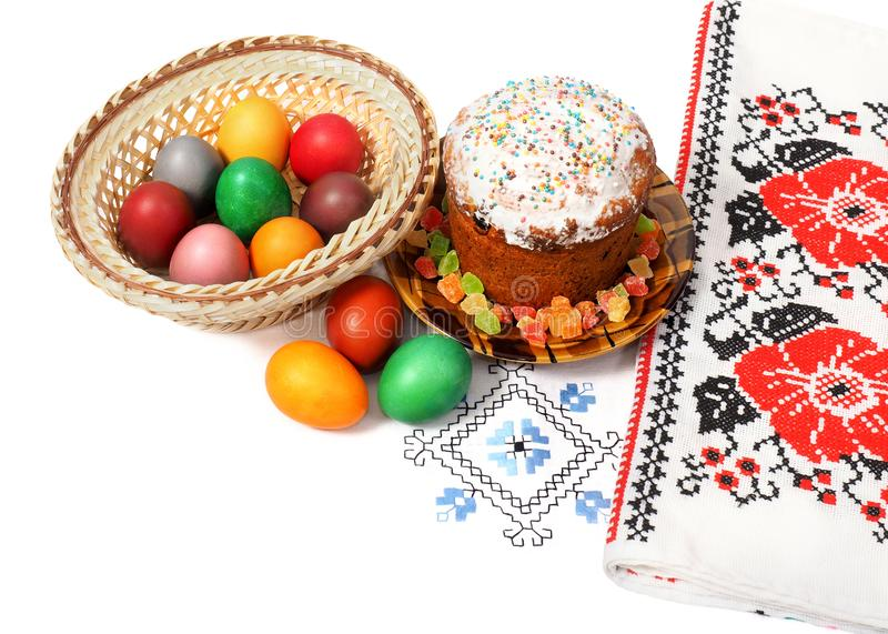 Easter holiday. Easter bread and eggs on a white tablecloth with patterns stock photo