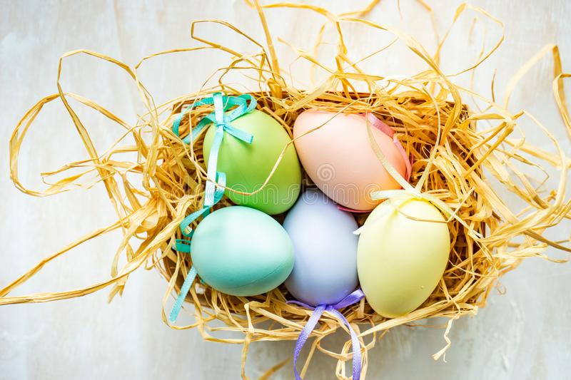 Easter holiday card concept. Easter holiday natural composition with first spring flowers like tricolor violas and primerose , colored eggs stock images