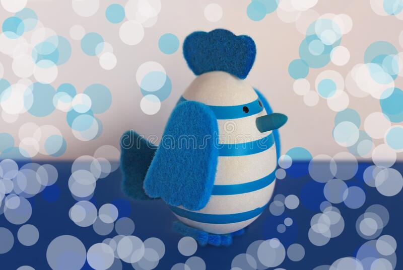 Easter holiday card with cute blue and white egg Chick toy with felt wings, tail and tuft.Trendy color of 2020 year. Easter holiday card with cute blue and white stock photography