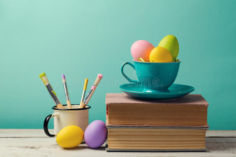 Easter holiday celebration with handmade painted eggs in coffee cup. stock photos