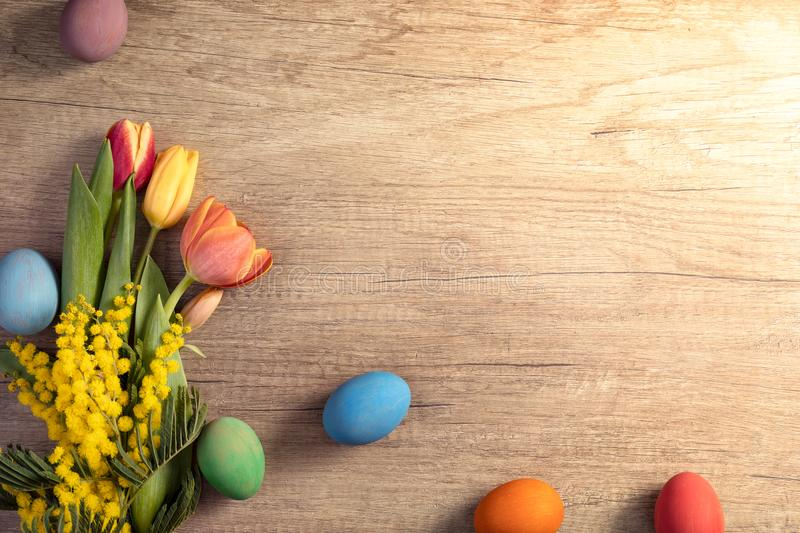 Easter holiday concept. Easter eggs with tulips on wooden board, Easter holiday concept. Copy space for text stock photography