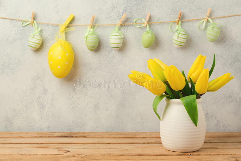 Easter holiday concept with tulip flowers and eggs decorations hanging stock images