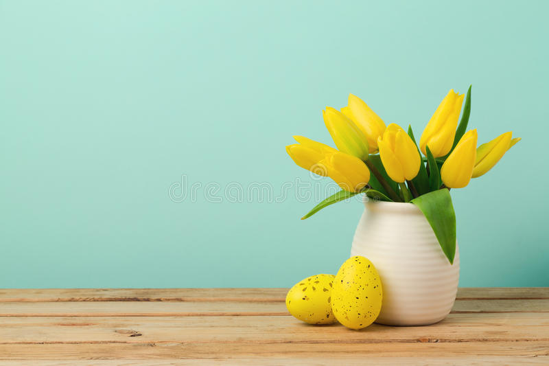 Easter holiday concept with tulip flowers and eggs decorations on wooden table royalty free stock photos