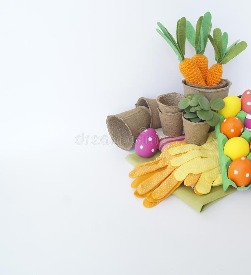 Easter holiday. Easter eggs and carrots. Knitted carrot. royalty free stock photos