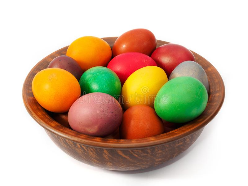 Easter holiday. Easter eggs in a clay plate on a white background isolated stock images