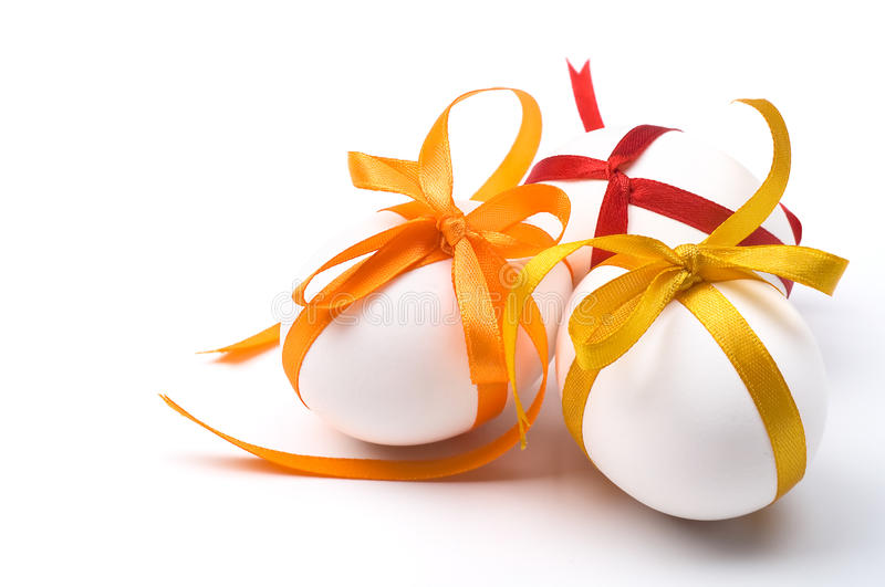 Easter holiday eggs with colorful bows. And space for text stock photography