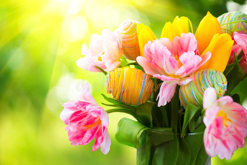 Easter holiday flowers bunch. With colourful eggs stock photos