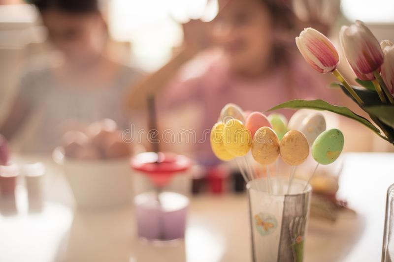 Easter is a holiday full of cheerful colors. Little girls coloring Easter egg royalty free stock photos