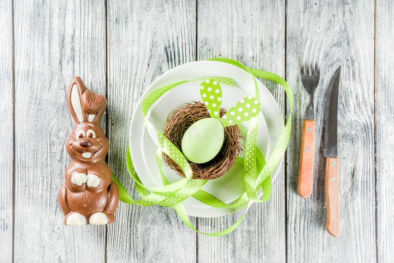 Easter holiday table setting with rabbits and eggs royalty free stock photography