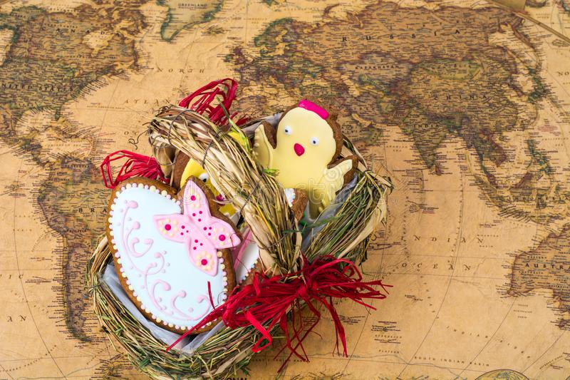 Easter holiday travel on different countries. Beautiful glazed cookies, world map. Studio Photo stock images