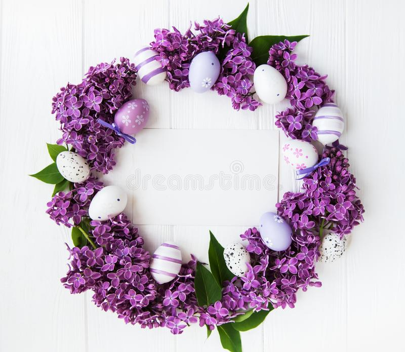 Easter holiday wreath. With eggs and lilac flowers stock photo