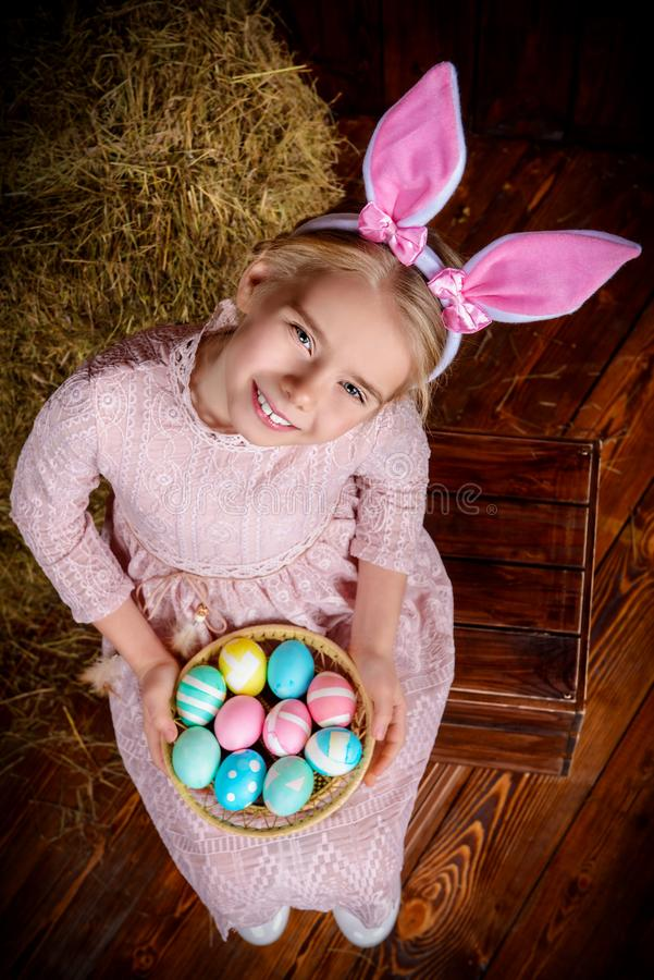 Girl in easter bunny costume stock photo