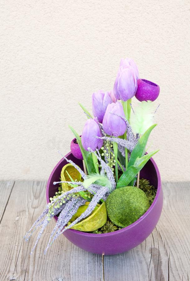 Easter home decoration. Easter floral home decoration on the table. Homemade arrangement stock photography
