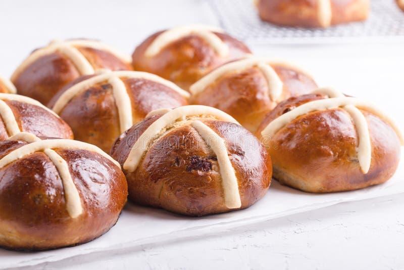 Easter hot cross buns on light background. Traditional Easter hot cross buns on holiday table on light background stock photo