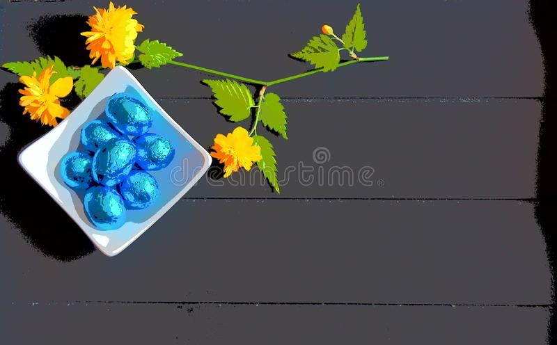 Easter image blue chocolate eggs and dark wooden background stock image